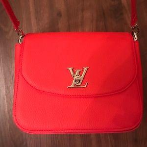 Used LV saddle bag